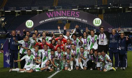Wolfsburg team celebrate with the trophy after beating Olympique Lyon in their women's UEFA Champions League final soccer match in London